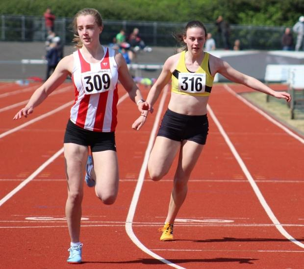 Isle of Wight County Press: Holly Whitter (in yellow) crosses the line in the 100m.