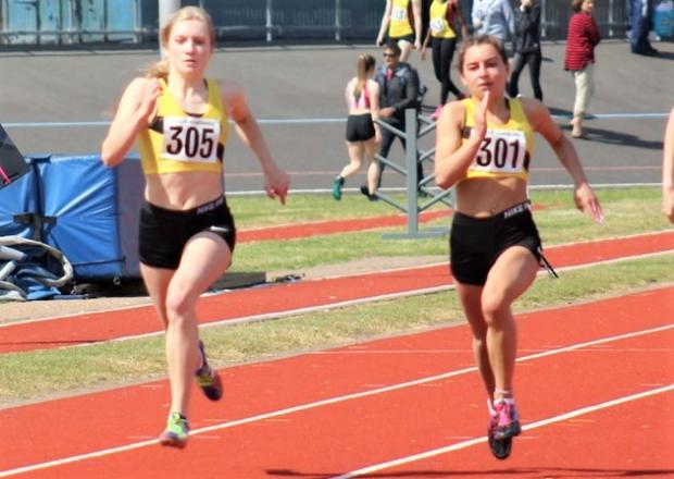 Isle of Wight County Press: Lucy Drover, left, and Mollie Butler compete in the 100m sprint.
