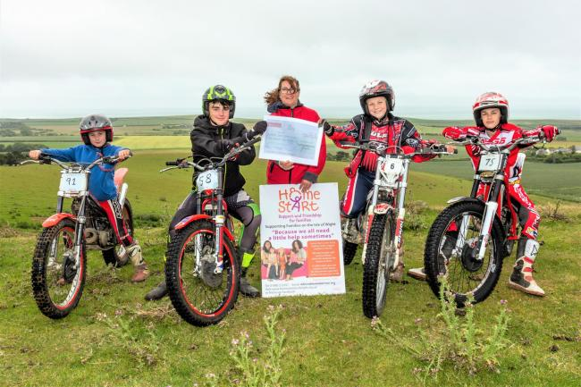 Home-Start IW specialist support worker, Rachael Brodie receiving a cheque, flanked by young trials riders of the IW Motorcyle Club, from left; Bertie Grieve, Dan Locke, Alfie Haydon and Alfie Gaskin.  Photo: Vicki Taylor
