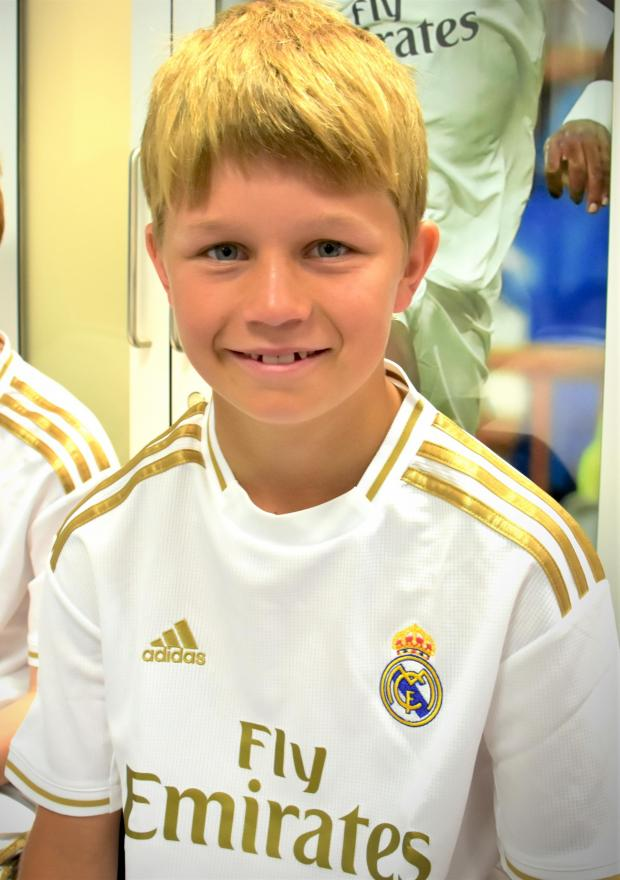 Isle of Wight County Press: Charlie Hart in his new Real Madrid kit in the first team's changing room.