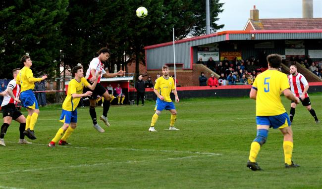 Newport and East Cowes Vics, pictured in action last season, have tough ties in the first round proper of the FA Vase.