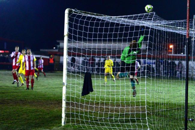 East Cowes Vics keeper Karl Steinborne-Busse pulling off an acrobatic save to deny a Spike Pearce bullet header.  Photos: Paul Blackley