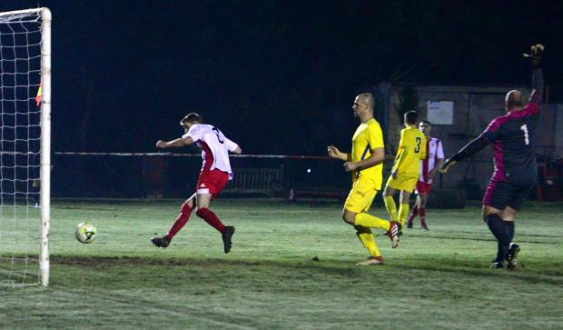 Isle of Wight County Press: Jimmi Burton scores for Vics, but was flagged for offside when the score was still 1-0 to Newport.