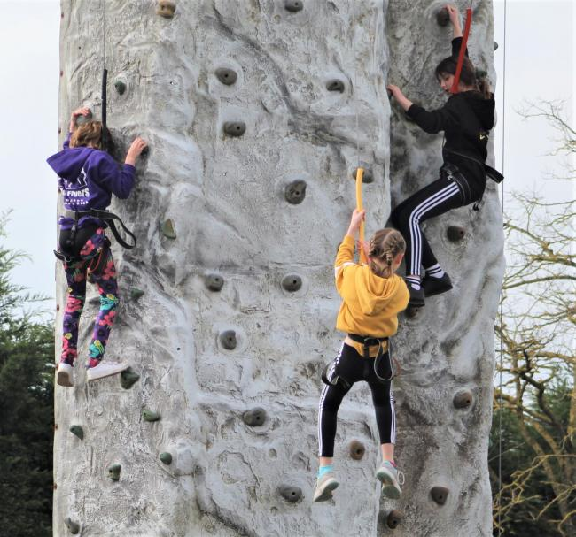Newport CE Primary School Years 4 to 6 pupils, from left, Molly Harwood, Lyla Peach and Esme Sweatman taking on the 30ft climbing wall for Sports Relief.