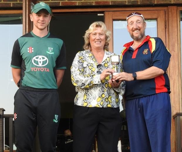 Isle of Wight County Press: Isle of Wight Development XI captain, Ross Whyte, left, with Isle of Wight Cricket Board director Kate Barton, presenting the Keith Newbery Memorial Trophy to MCC captain, Andy Woodward, at Newclose on Sunday.