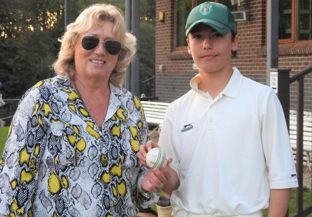 Isle of Wight County Press: MCC v IW Development XI at Newclose — Oscar Vandecasteele receives the match ball from IW Cricket Board director, Kate Barton, after being named man of the match.