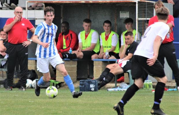 Isle of Wight County Press: Ewan Cranwell in action for Cowes Sports against Devizes Town in the FA Vase on Saturday.