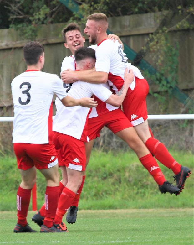 Isle of Wight County Press: Vics celebrate their goal against Westbury.