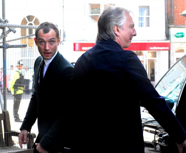 Ten years ago: Film stars Jude Law, left, and Alan Rickman arrive at the Minster Church of Sts Thomas, Newport, to attend the thanksgiving service for the life of Anthony Minghella, the Island-born, Oscar-winning film director. Both the Hollywood stars ga