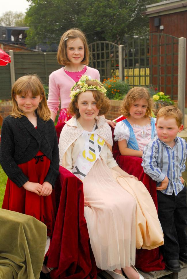 Atalanta Hersey, in her role as Havenstreet May Queen, was to crown her twin sister, Miranda, her successor. Pictured, back, Atalanta Hersey, 12. Front, from left, Lauren Ball, eight, Miranda Hersey, 12, Daisy May Corby, five, and Logan Ball, three.