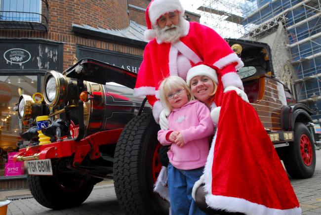 Ten years ago: Chitty Chitty Bang Bang arrived with Santa, Phil Crombleholme, and his granddaughter Emma Matthews. Santa was advertising his weekends at Thompsons Nursery in aid of Island Diabetics and Hope Giles, three, came over to say hello.